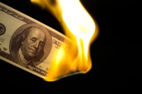 Image of 100 bill burning