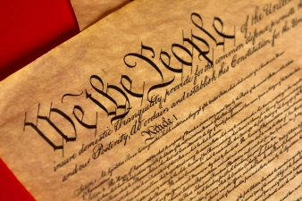 Parchment of the Constitution with a red background